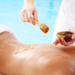 Spa Treatment - woman undergoing spa treatment with honey.