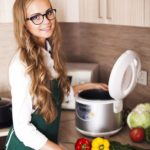 beautiful girl in the kitchen with slo-cooker